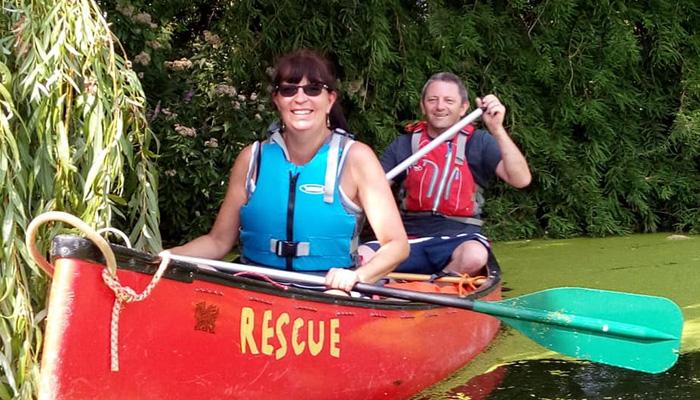 Paul Rollings paddling an open boat