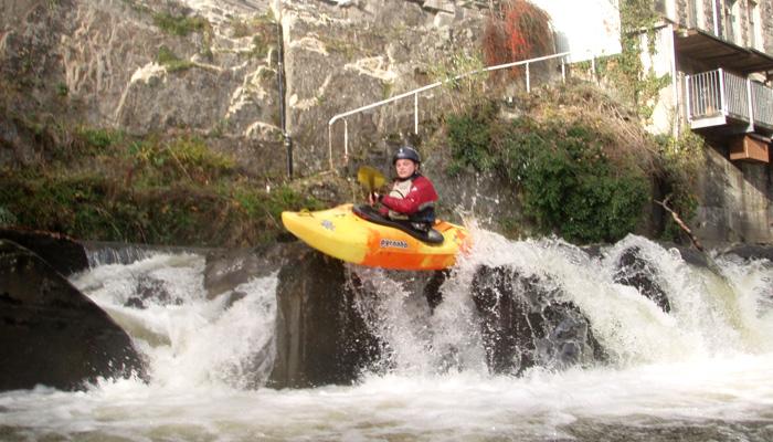 Paddling rapids at Rhayader on Upper Wye
